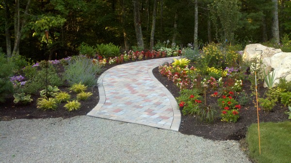 walkway with flower beds