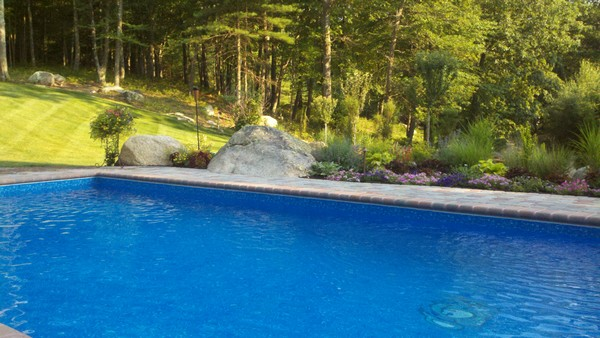 pool deck with flower bed